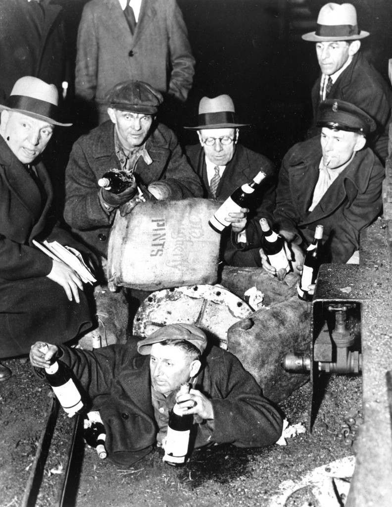 Prohibition agents uncover about $300,000 worth of liquor concealed in a pile of coal when they boarded the coal steamer Maurice Tracy in New York harbor on April 8, 1932. The inspectors shovelled coal for about an hour before they discovered the 3,000 bags of bottled beverages. (AP Photo) Ref #: PA.2823668  Date: 08/04/1932