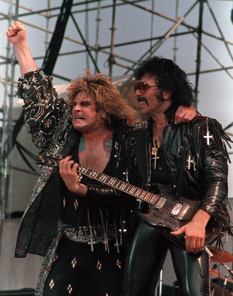 Ozzy Osbourne, left, and Tony Iommi of Black Sabbath perform during the Live Aid concert in Philadelphia, Pa., July 13, 1985. (AP Photo/Rusty Kennedy)   PA-2834172