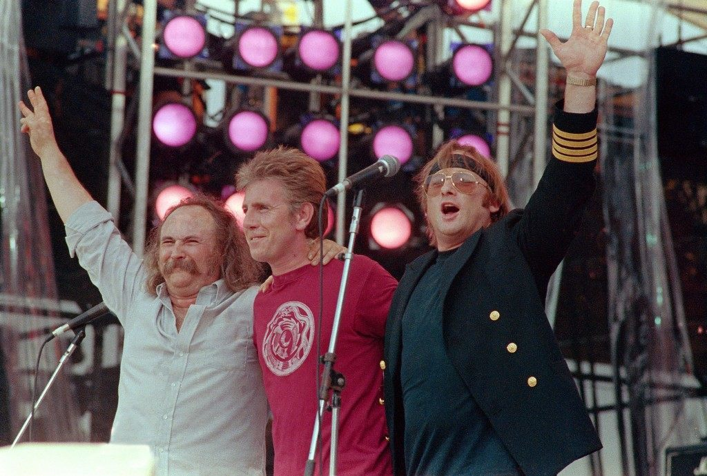 From left, David Crosby, Graham Nash and Stephen Stills, performing collectively as Crosby, Stills and Nash, acknowledge the crowd during the Live Aid concert for famine relief at JFK Stadium in Philadelphia, Pa. July 13, 1985.(AP Photo/Amy Sancetta) PA-2850715