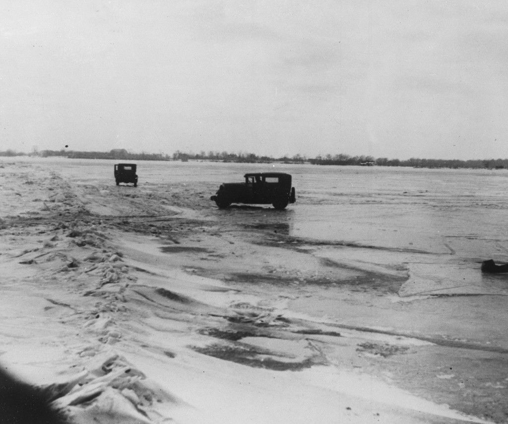 Large quantities of Canadian beer and whisky are being transported in cars from Amherstburg, Ont., Canada, across the frozen lower Detroit River, to the Michigan side of the international boundary line, Feb. 14, 1930. The cars are driven with one door open, so if the car goes through the ice the driver can scramble free. (AP Photo) Ref #: PA.3325810 Date: 14/02/1930