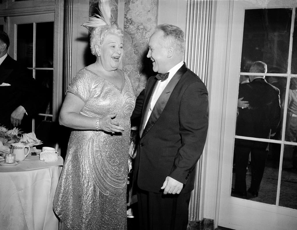 "Singer and entertainer Sophie Tucker, also known as ""The Last of the Red Hot Mamas,"" shares a moment with Joseph Cronin, mayor of Hartford, Conn., at a Golden Jubilee Dinner in her honor, at the Waldorf-Astoria Hotel, New York, October 4, 1953. (AP Photo) Ref #: PA.3346840"
