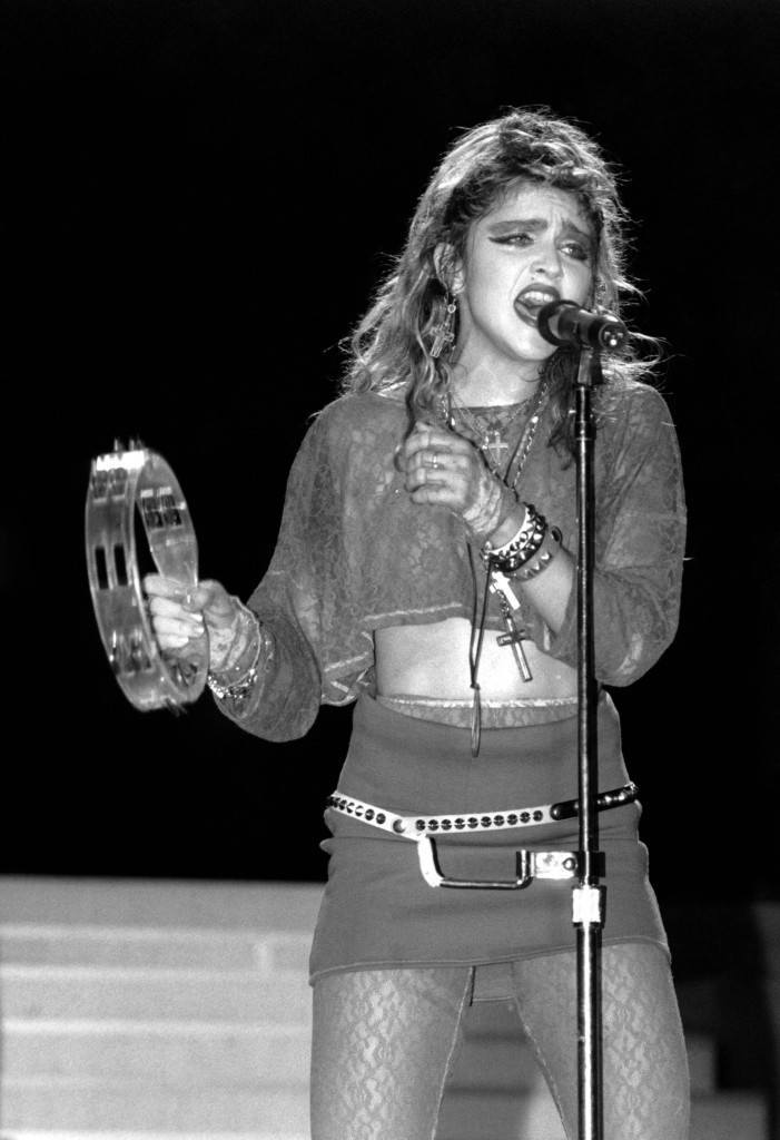 Madonna sings during a Live Aid concert in Philadelphia's JFK Stadium on July 13, 1985. (AP Photo/Rusty Kennedy)  PA-3353845