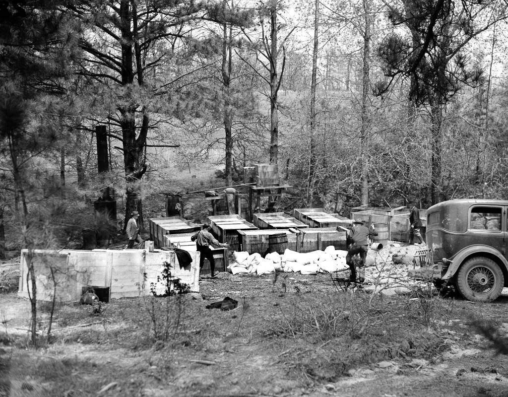 U.S. Federal agents raid an illegal liquor plant near Griffin, Ga., where beer and wine are legal, on May 5, 1937. This plant in Lamar County is worth several thousand dollars. (AP Photo) Ref #: PA.3388998 Date: 05/05/1937