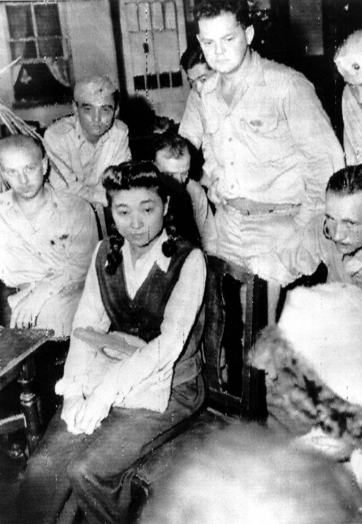 "Iva Toguri D'Aquino is interviewed by American journalists in Yokohama, Japan on Sept. 10, 1945, shortly before she is held in detention. D'Aquino, identified by the U.S. 8th Army headquarters as Tokyo Rose, is a radio personality whose program ""Zero Hour"" broadcast Japanese propaganda to the Allied troops during World War II. (AP Photo) Ref #: PA.3712715"
