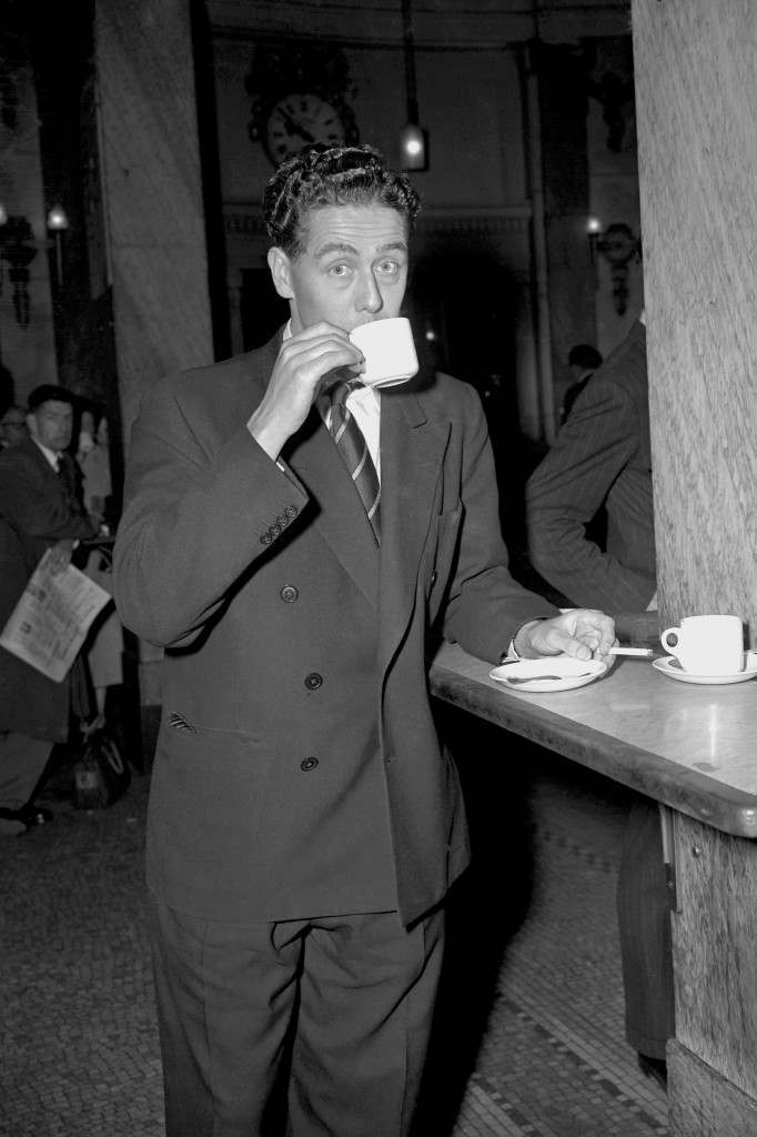 England's Trevor Bailey, who missed the train carrying the tour party, relaxes with a cup of tea and a cigarette at the Waterloo Station buffet while waiting for the next train to Southampton, from where the England team set sail for South Africa Ref #: PA.3790400  Date: 04/10/1956