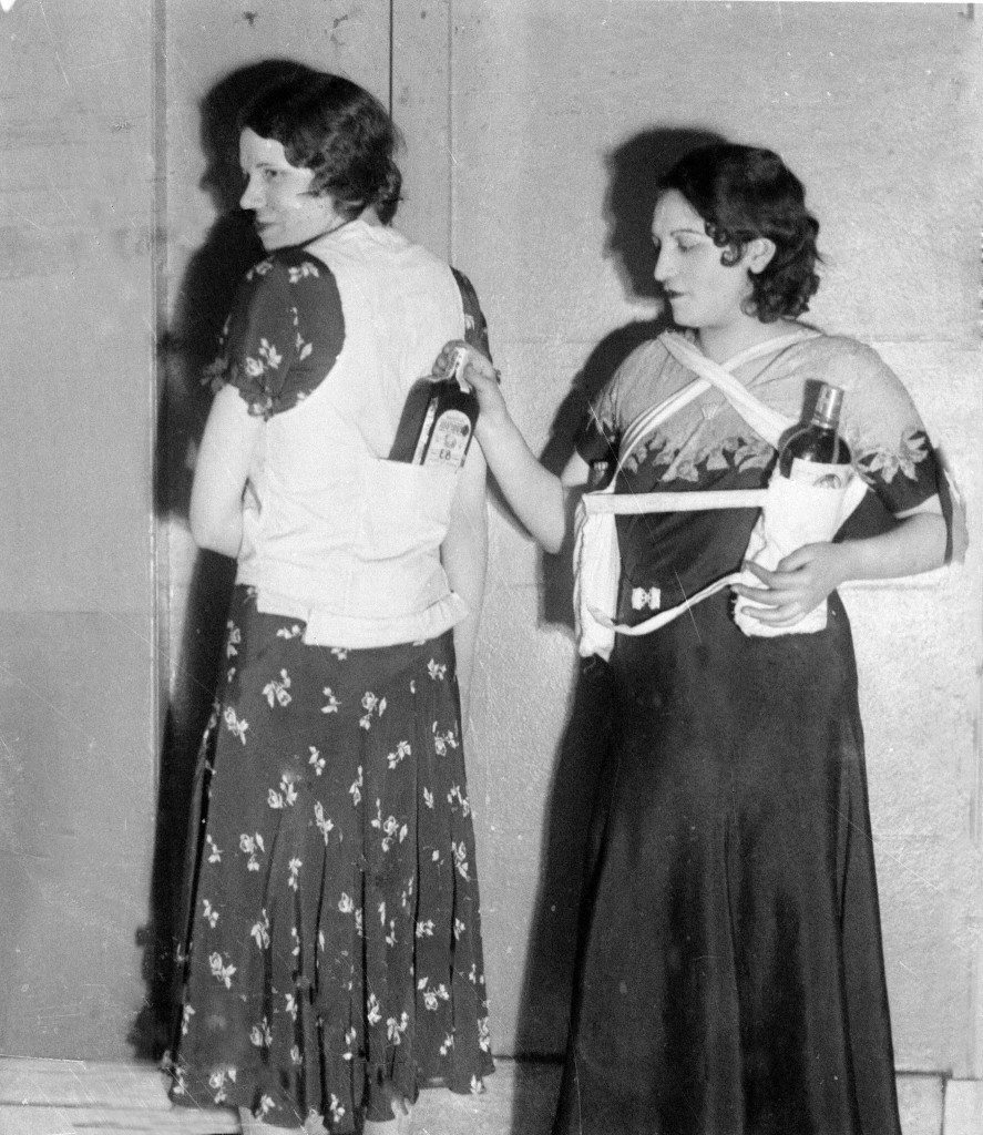 Estelle Zemon, left, and an unidentified woman model ways to conceal bottles of rum to get past customs officials during the U.S. alcohol prohibition, March 18, 1931. (AP Photo) Ref #: PA.3874952 Date: 18/03/1931