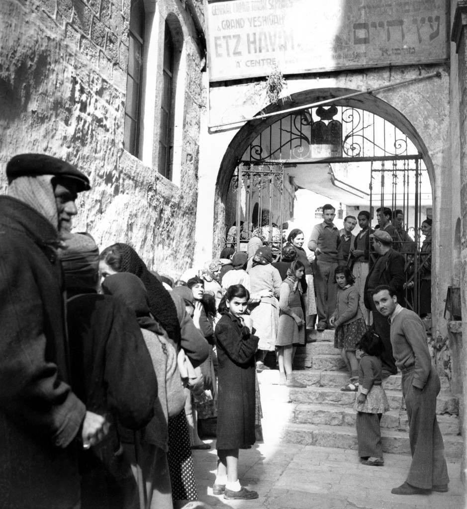 Jews in the Old City section of Jerusalem queue up to await distribution of provisions brought into the city by British Army convoy on Jan. 19, 1948. (AP Photo/James Pringle) Ref #: PA.3946699 Date: 19/01/1948