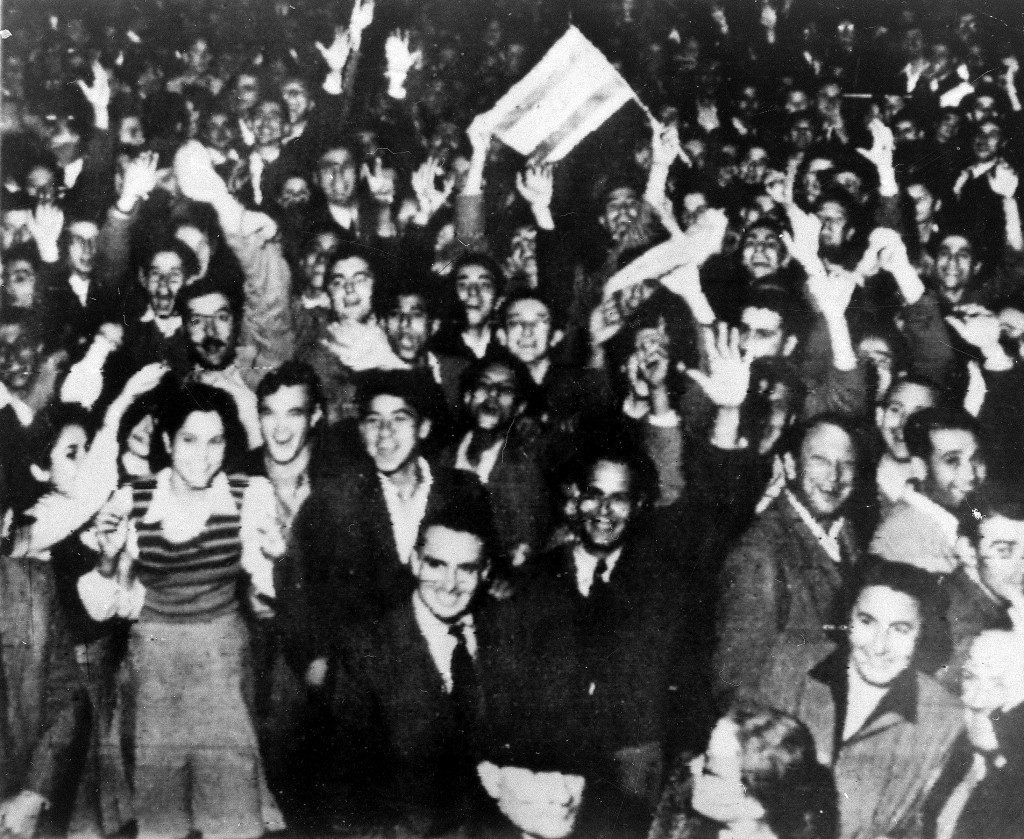 Jewish residents wave jubilantly in the streets in Tel Aviv, Israel. Celebrations began after the United Nations voted to partition Palestine into separate Jewish and Arab states. Ref #: PA.4183478 Date: 29/11/1947