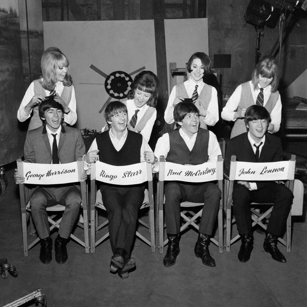 The Beatles, seated on chairs bearing their names, have their hair worked on by (l-r) Pattie Boyd, Tina Williams, Pru Berry and Susan Whiteman Ref #: PA.4271038 Date: 16/03/1964