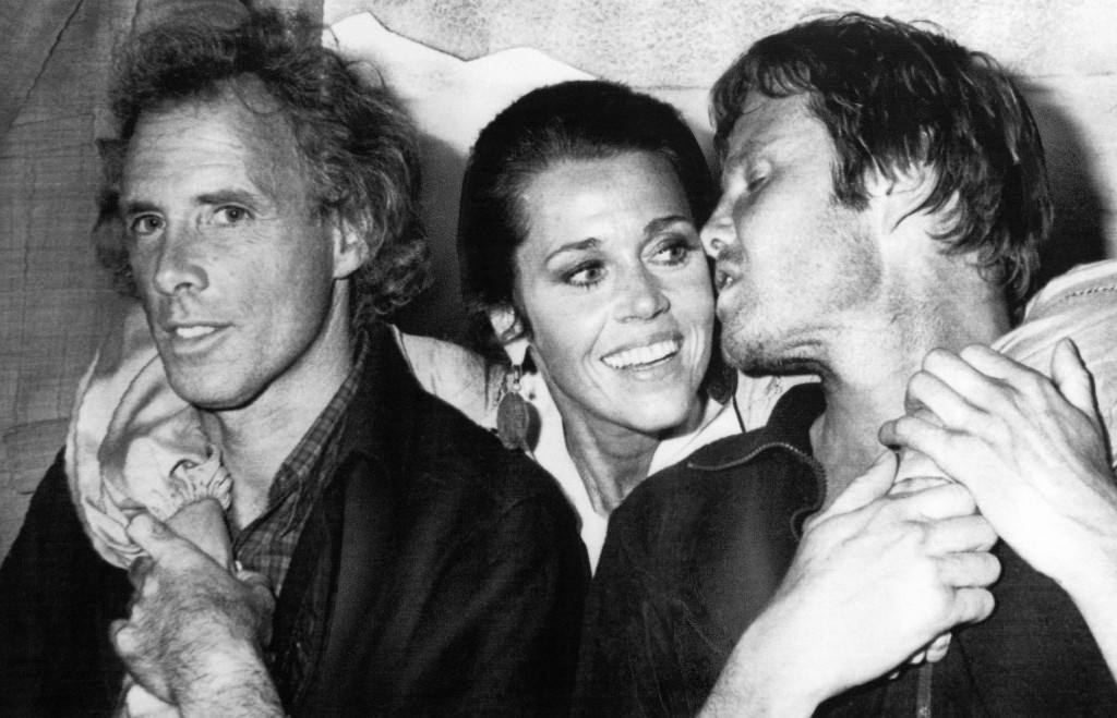 "CANNES, May 26, 1978-Actor Jon Voight , right , turns to kiss Jane Fonda May 26, 1978 as they pose with Bruce Dern, left. The three were at the 31st International Film Festival at Cannes for the screening of the us film ""Coming Home"" in which they star. (AP Photo/Jean Jacques Levy) Ref #: PA.4571637  Date: 26/05/1978"
