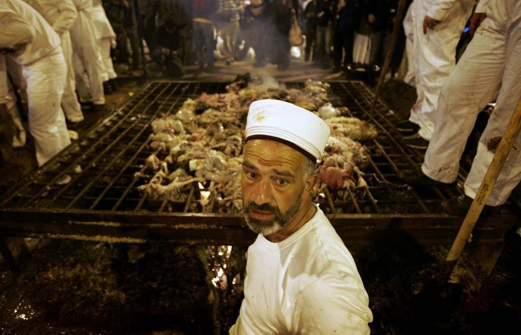 Samaritans priest burn the entrails of sheep during the ritual of Sacrifice, part of a Samaritan Passover ceremony, in Mount Grizin, overlooking the West Bank town of Nablus, Tuesday May 1, 2007. Samaritans descended from the ancient Israelite tribes of Menashe and Efraim but broke away from mainstream Judaism 2,800 years ago. Today, the remaining 700 Samaritans, live in the Palestinian city of Nablus in the West Bank and the Israeli seaside town of Holon, south of Tel Aviv. (AP Photo/Emilio Morenatti) Ref #: PA.4613085  Date: 25/04/2007