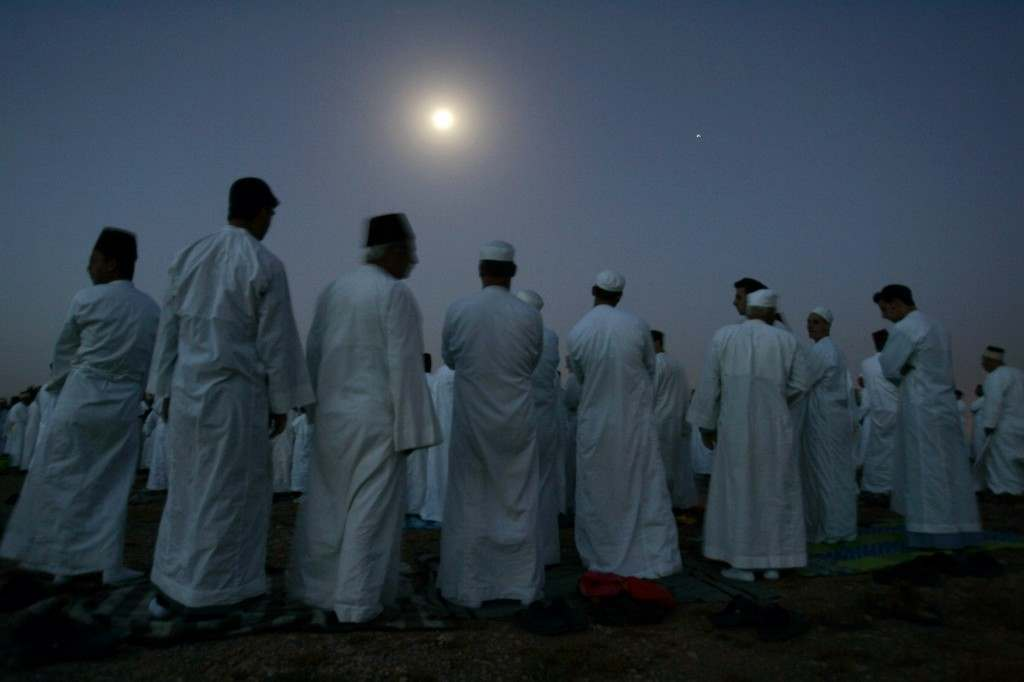 Members of the Ancient Samaritan community pray during a pilgrimage marking the end of the holy day of Passover at the religion's holiest site on Mount Gerizim near the West Bank town of Nablus, early Monday, May 7, 2007. According to tradition, the Samaritans are descendants of Jews who were not deported when the Assyrians conquered the area in the 8th century B.C. Of the small community of close to 700 people, half live in a village at Mount Gerizim, and the rest in the city of Holon near Tel Aviv. (AP Photo/Ariel Schalit) Ref #: PA.4631692  Date: 07/05/2007
