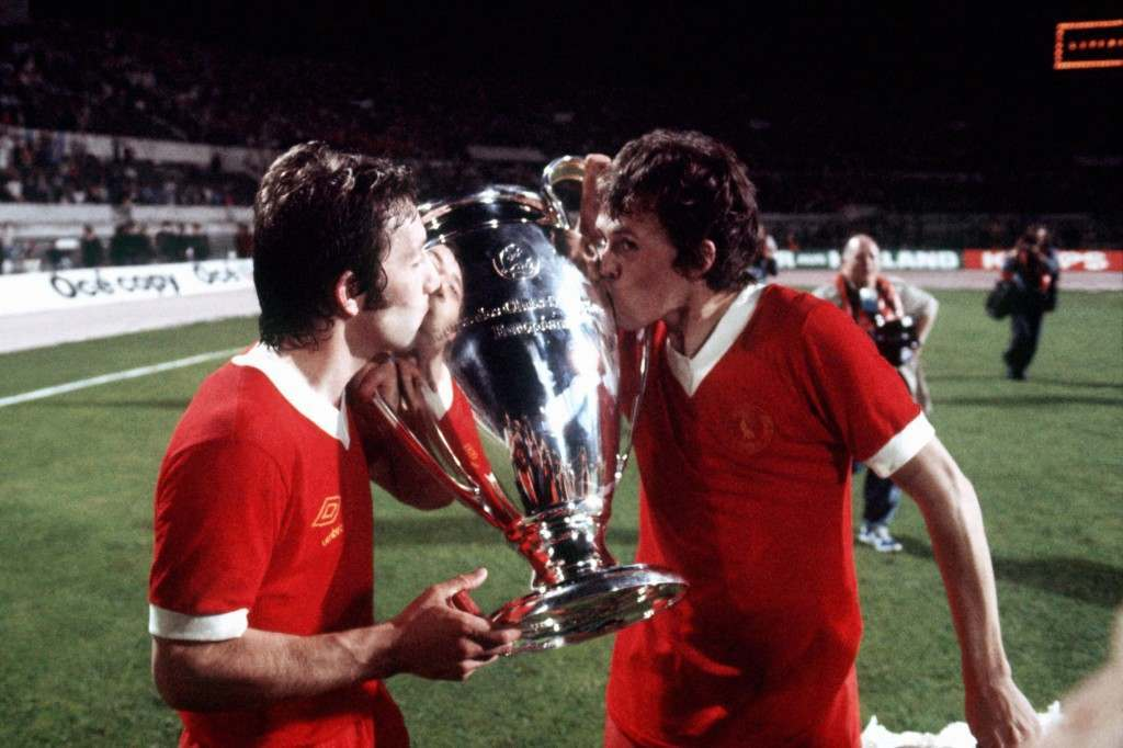 Soccer - European Cup - Final - Liverpool v Borussia Monchengladbach (L-R) Liverpool's Jimmy Case and Phil Neal, who scored the final goal, kiss the European Cup NULL Ref #: PA.473775  Date: 25/05/1977