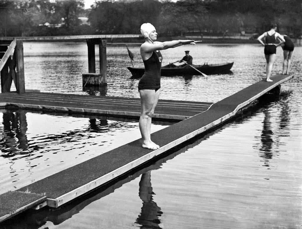 Miss Eva Coleman, who intends to attempt the Channel swim this summer, is using the Hyde Park Lido as a training ground. Her trainer, Burgess, considers she has a good chance of breaking the record set up by Gertrude Ederle. Picture shows Miss Eva Coleman about to take the plunge at the Lido Ref #: PA.477627  Date: 19/05/1932