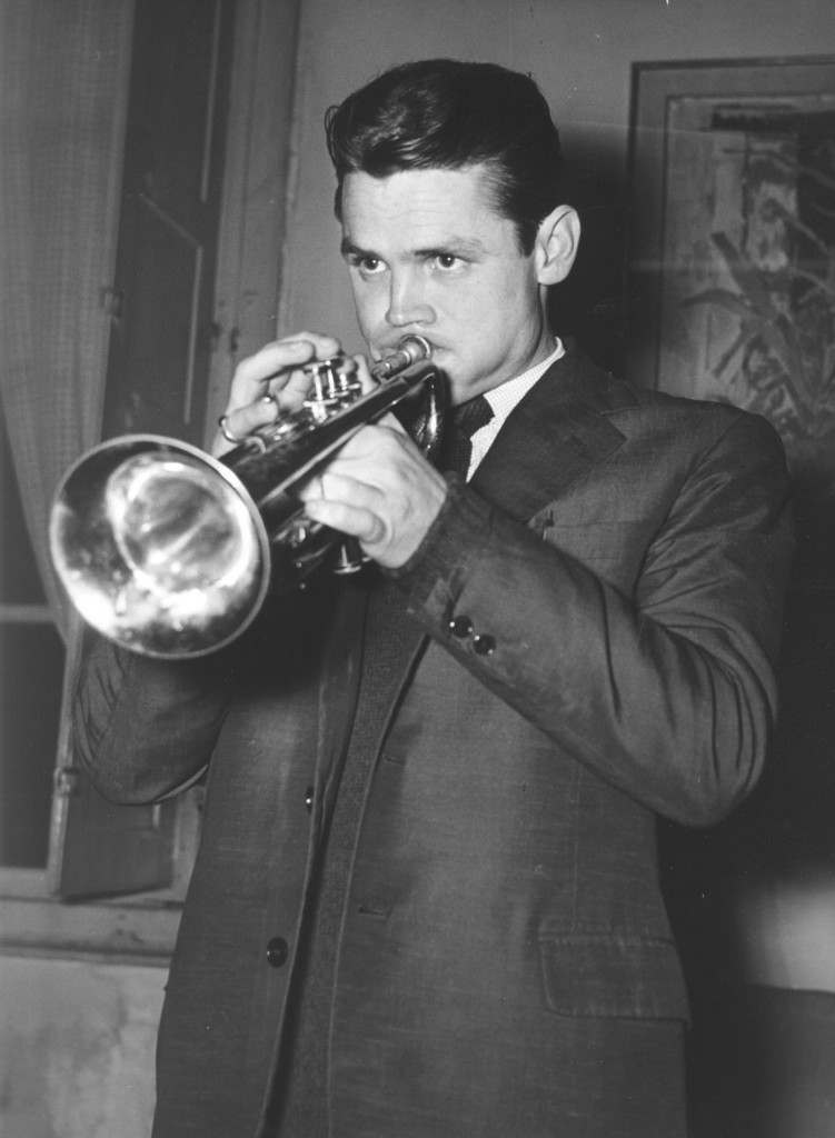 Chet Baker released from Jail. American jazz trumpeter Chet Baker sounds his trumpet in his Italian attorney's office at Lucca, west of Florence, after he was released from jail there Dec. 15, 1961. Chet Baker was sentenced to one year, 4 months and 5 days' imprisonment, in September 1960, for having illegally kept and having used drugs. (AP-Photo/Giulio Torrini) 15.10.1961 Ref #: PA.4809677