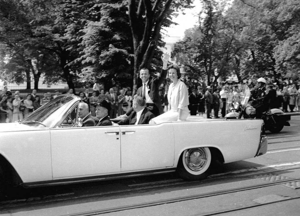 Pioneering Mercury astronaut Alan Shepard and his wife Louise Shepard, sit in a car as they leave the White House May 8, 1961 after Shepard was presented with the NASA distinguished service medal by President Kennedy. In the car with the Shepards is Vice President Johnson. (AP Photo) Ref #: PA.4932854