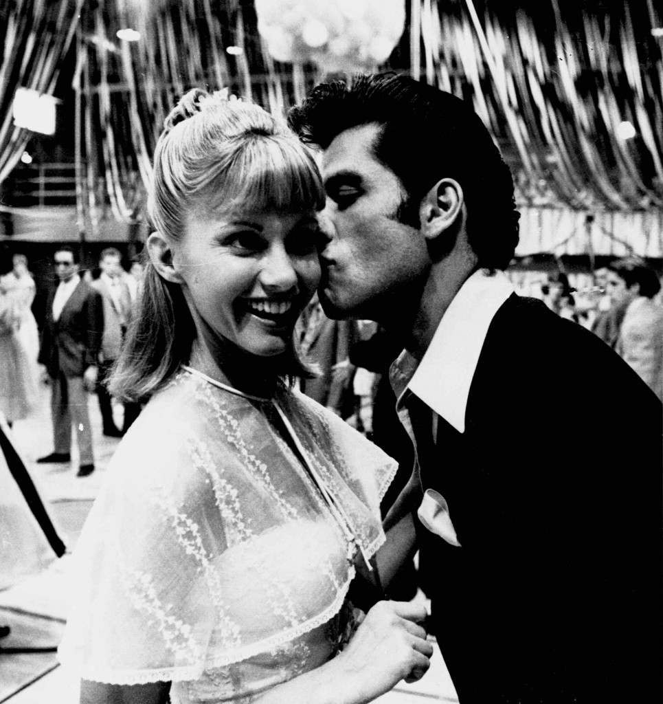 """John Travolta, America's hearthrob as TV's """"Barbarino,"""" plants a first screen kiss on Olivia Newton-John, popular singing star, as the two rehearse a scene for the movie version of """"Grease,"""" September 7, 1977.(AP Photo/ho) Ref #: PA.4942761  Date: 07/09/1977"""