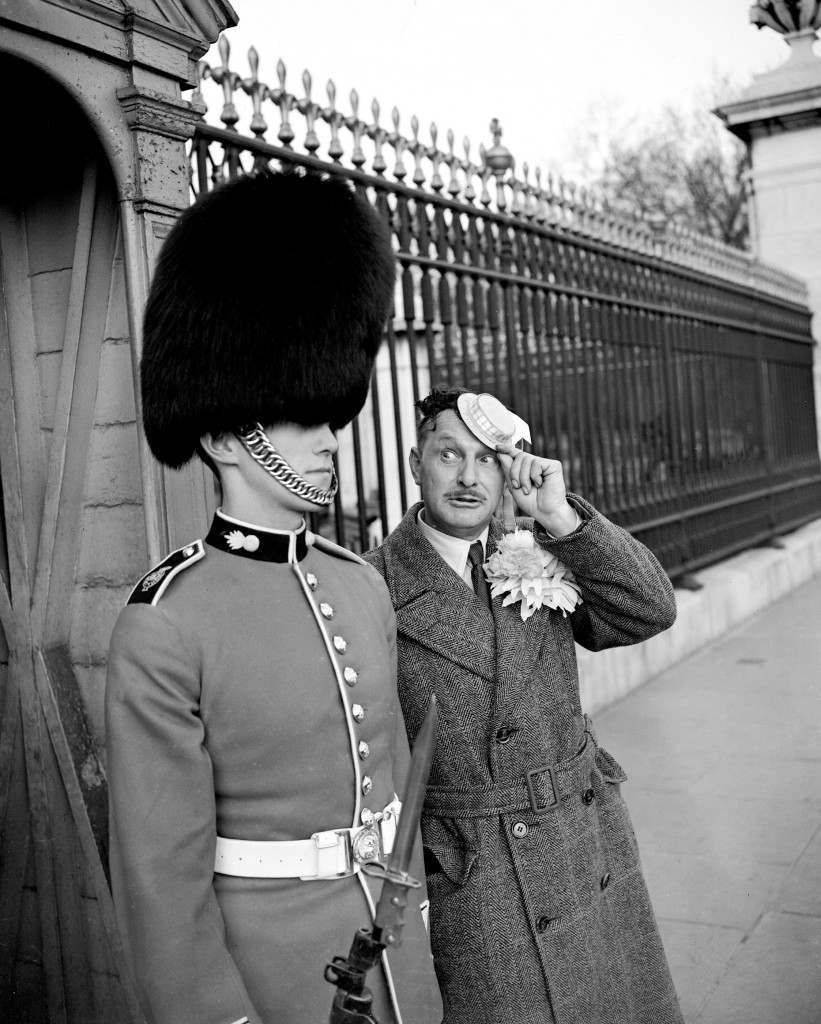 Soccer - FA Cup Final - Blackpool v Newcastle United - Wembley Stadium Pre match, F.A. Cup Final. A fan is snapped next to a Grenadier Guard. Ref #: PA.4951661  Date: 28/04/1951