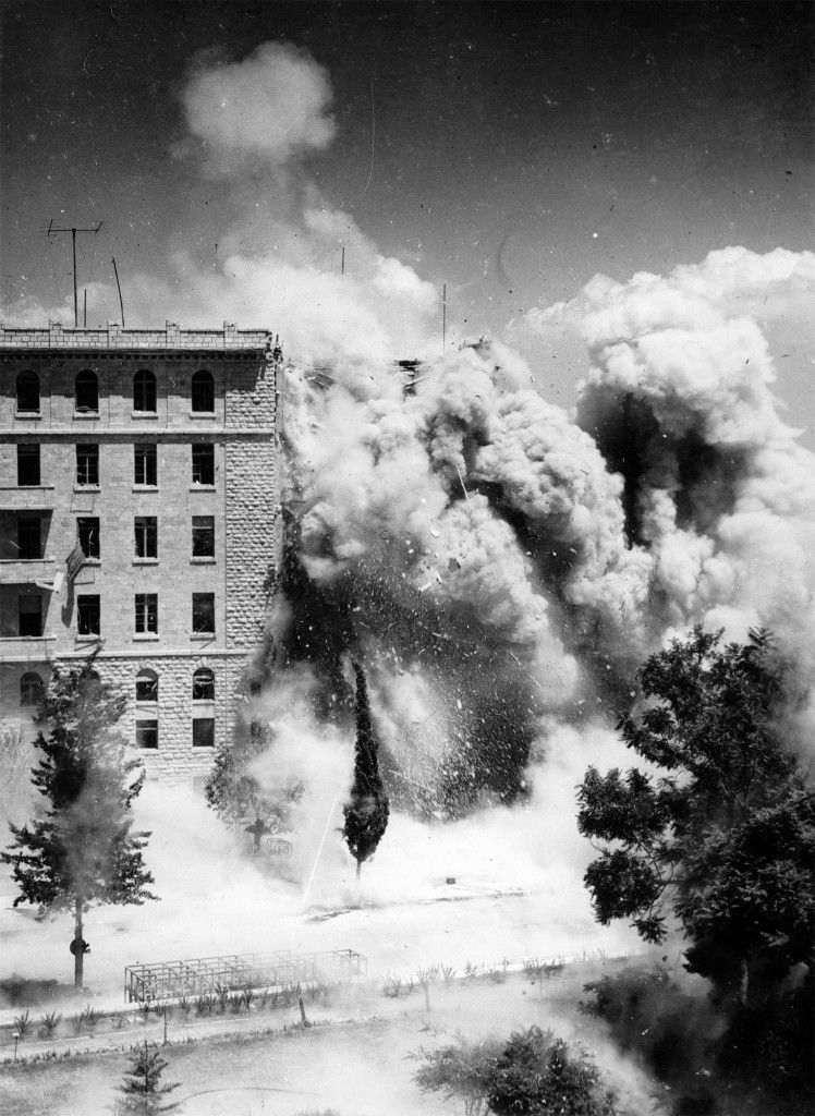 A general view of the King David hotel, Jerusalem, as sappers set off a charge to explode away from the main part of the hotel, while carrying out demolition work, July 29, 1946 - a week after the bomb outrage. (AP-Photo/noel) Ref #: PA.5175023 Date: 29/07/1946