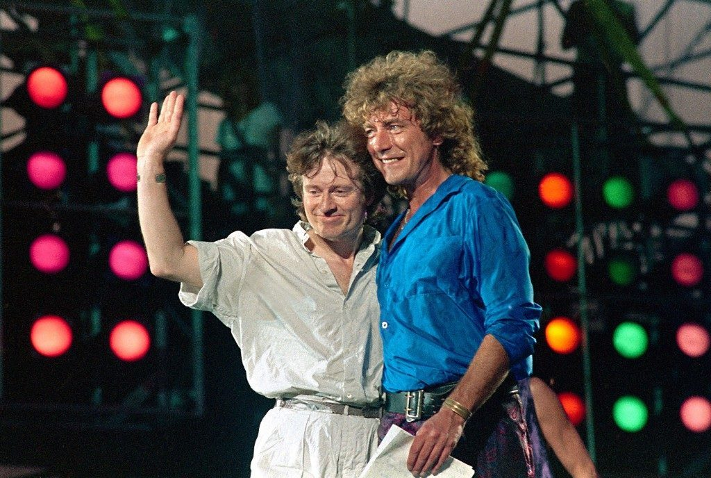 "Former Led Zeppelin bandmates, bassist John Paul Jones ,left, and singer, Robert Plant, appear onstage at JFK Stadium in Philadelphia Pa. during the Live Aid famine relief concert, in this July 13, 1985 file photo. Led Zeppelin, one of the last major acts to resist digital distribution, are releasing their back catalog online. Songs including ""Communication Breakdown,"" ""Whole Lotta Love"" and ""Stairway to Heaven,"" will be available from online music stores Nov. 13. The band is due to release a two-CD retrospective, ""Mothership,"" the same day. (AP Photo/Amy Sancetta) PA-5243680"