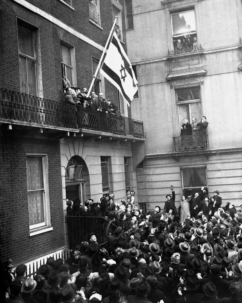 The flag of the Israeli Government, proclaiming the recognition of the government by Britain, was hoisted at the offices of the Israeli Government in Manchester Square, London, by 17 year old Ruth Liebstadter, the youngest member of staff. Ref #: PA.5481788 Date: 31/01/1949