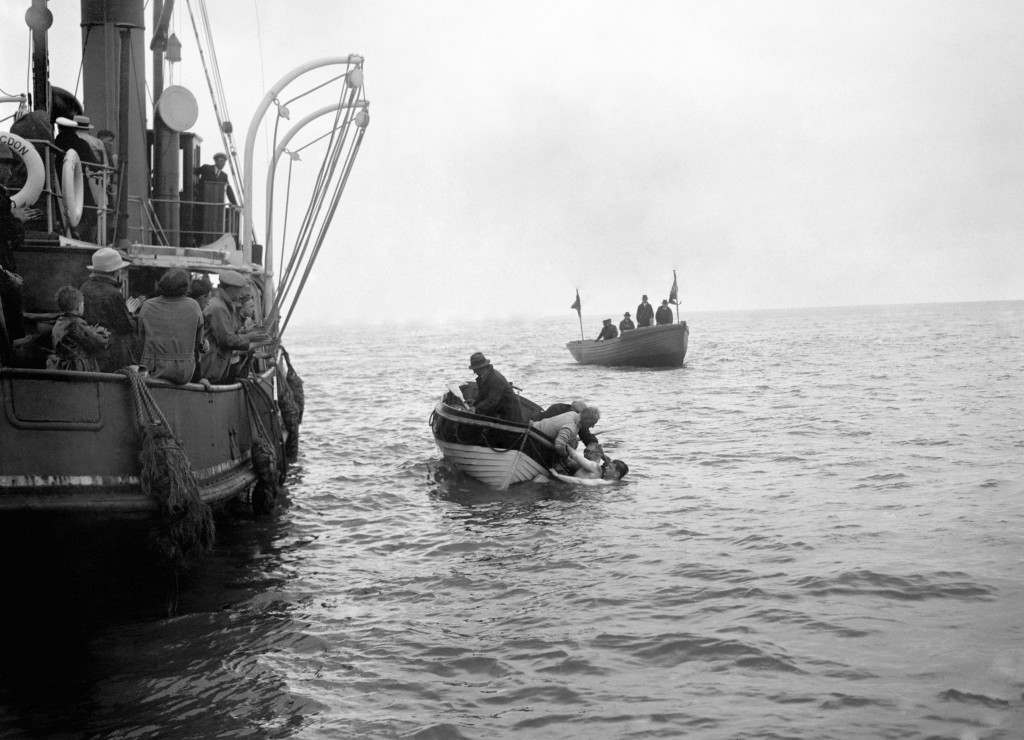 Lt. Colonel Freyberg being taken from the water into the rowing boat, only a quarter of a mile from the Kent coast, after attempting to swim the English Channel. Ref #: PA.5510548  Date: 05/08/1925