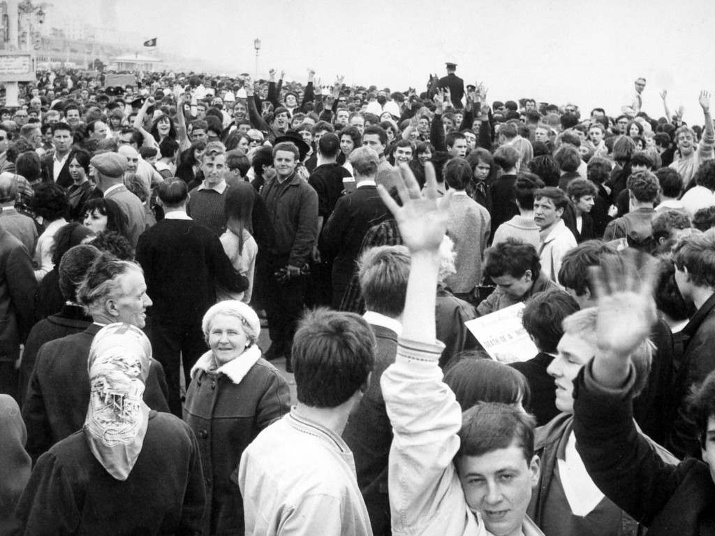 White helmeted policemen are lost in the surging crowd at the seafront, Brighton. After yesterdays battles at Margate Mods and Rockers desended on Brighton. Ref #: PA.5581342  Date: 18/05/1964