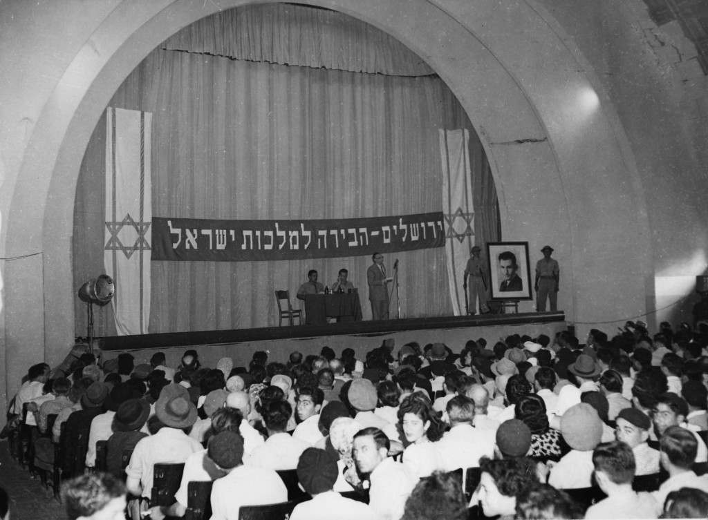 "Beneath a banner proclaiming ""Jerusalem, the capital of Israel"" Stern Group leaders address a large meeting in the Holy City, Jerusalem, Palestine, August 1948. (AP Photo) Ref #: PA.5736828 Date: 01/08/1948"