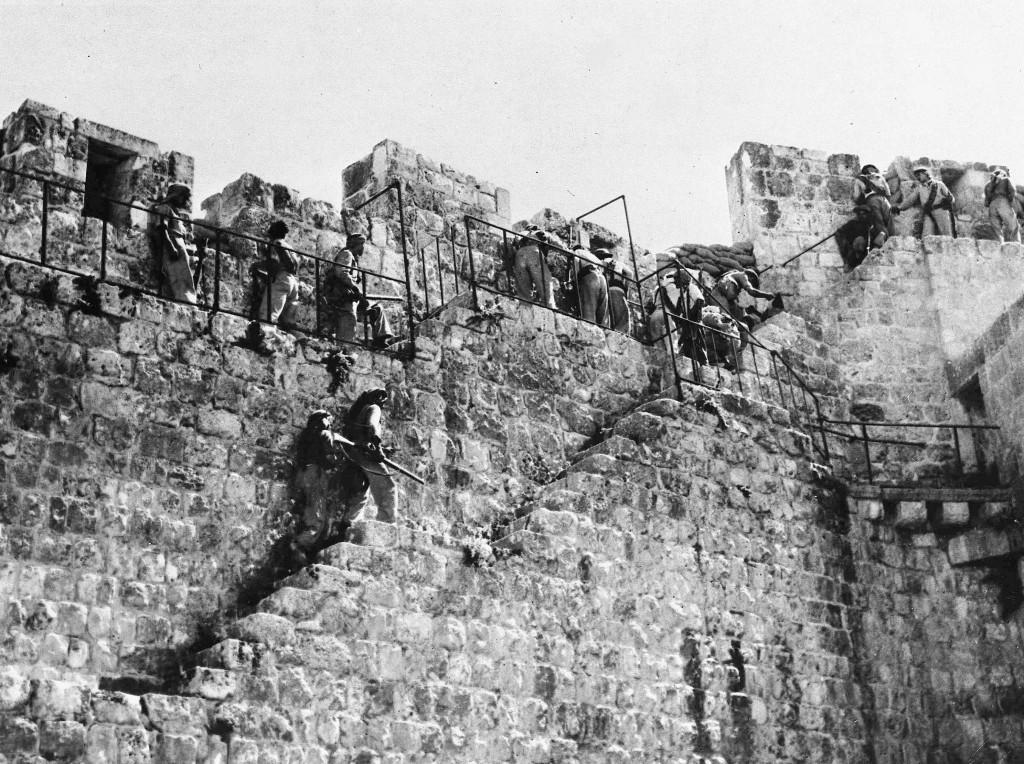 Arab Legion riflemen resume their front line positions along the battlements of the walls of the old city of Jerusalem, as the truce ends in Palestine, July 9, 1948. Jewish shelling has been concentrated on this sector since the end of the truce. (AP Photo) Ref #: PA.5736882 Date: 09/07/1948