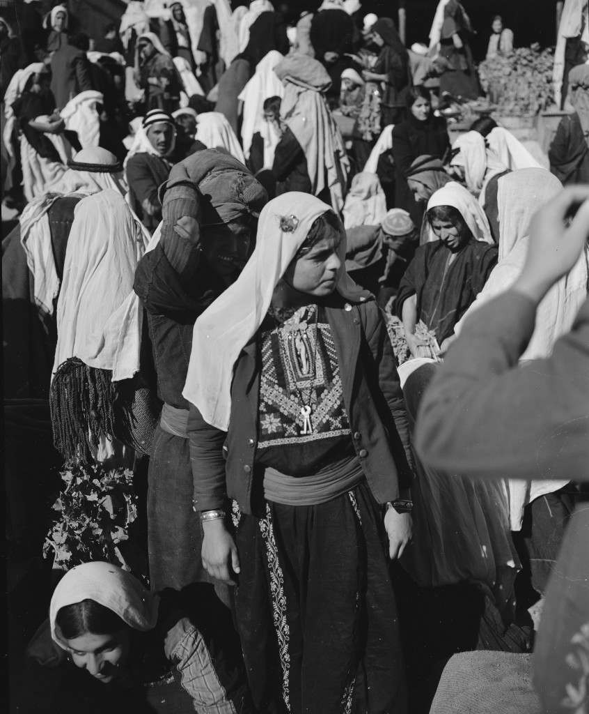 Arab girls shop in the market place near Manger Square in Bethlehem, Nov. 28, 1947. (AP Photo/Jim Pringle) Ref #: PA.5737158 Date: 28/11/1947