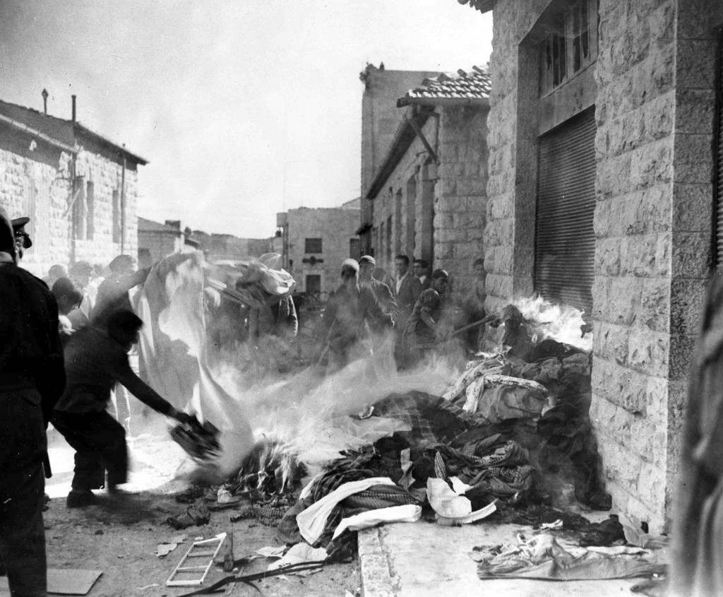 A crowd of arab demonstrators burn goods taken from Jewish homes in Jerusalem, Dec. 6, 1947, during the disturbances which broke out as the arabs staged a three-day strike against the partition plan. Jewish shops and homes in the quarter were attacked and some set on fire. (AP P hoto/Pringle) Ref #: PA.5737159 Date: 06/12/1947