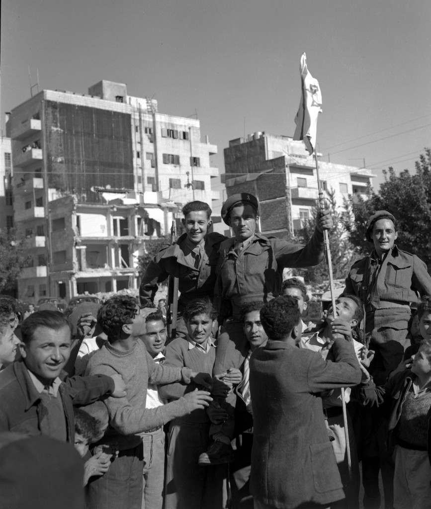 Jews who have been the enemies of the British for the past few years, have made up after hearing of the news of the declaration of the new Jewish State of Israel. Jews are seen hoisting British soldiers on their shoulders and holding the Israeli flag on Nov. 30, 1947 in Jerusalem. (AP Photo/Tom Pringle) Ref #: PA.5737169 Date: 30/11/1947
