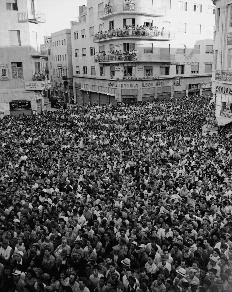 Some 4,000 people in Jerusalem listen to an address by Menachem Begin, from a balcony of the Tel Aviv hotel on Zion Square, August 11, 1948. (AP Photo) Ref #: PA.5737179 Date: 11/08/1948