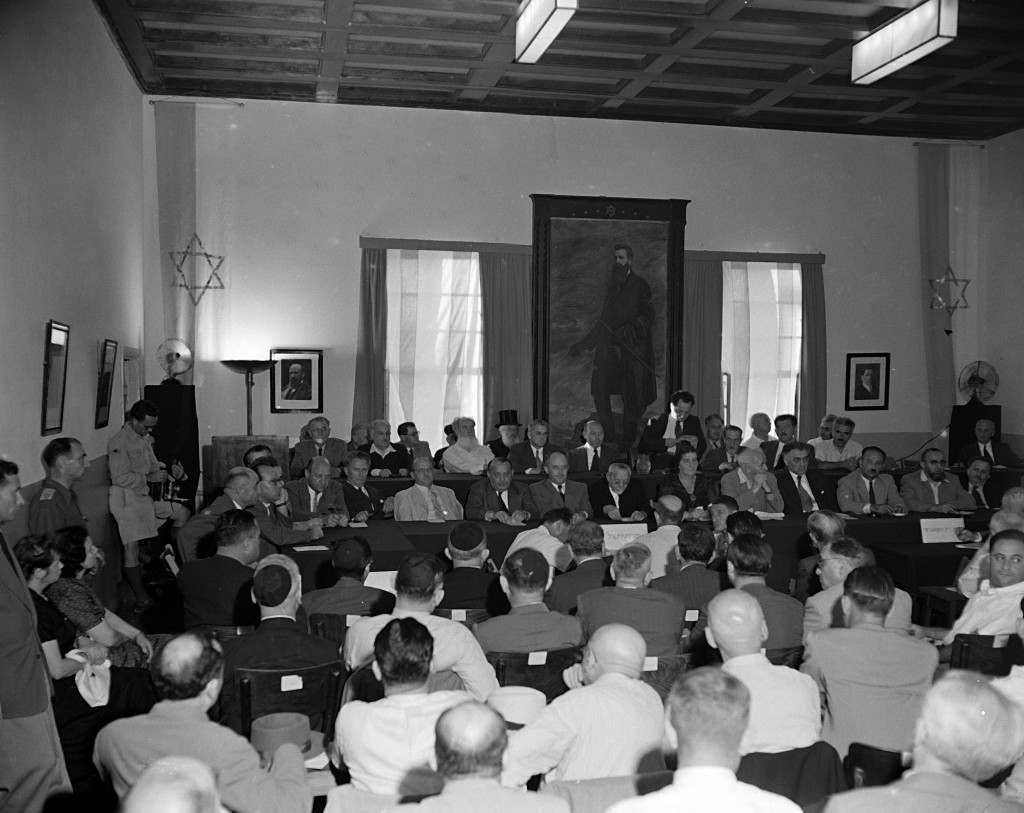 Members of the General Zionist Council meet for the first time since the establishment of the state of Israel, Aug. 28, 1948. The painting is of Theodore Herzl, founder of the first General Zionist Movement. Mr. S. Sprinzak (first name not available), chairman of the council, addresses the audience. (AP Photo) Ref #: PA.5737198 Date: 28/08/1948