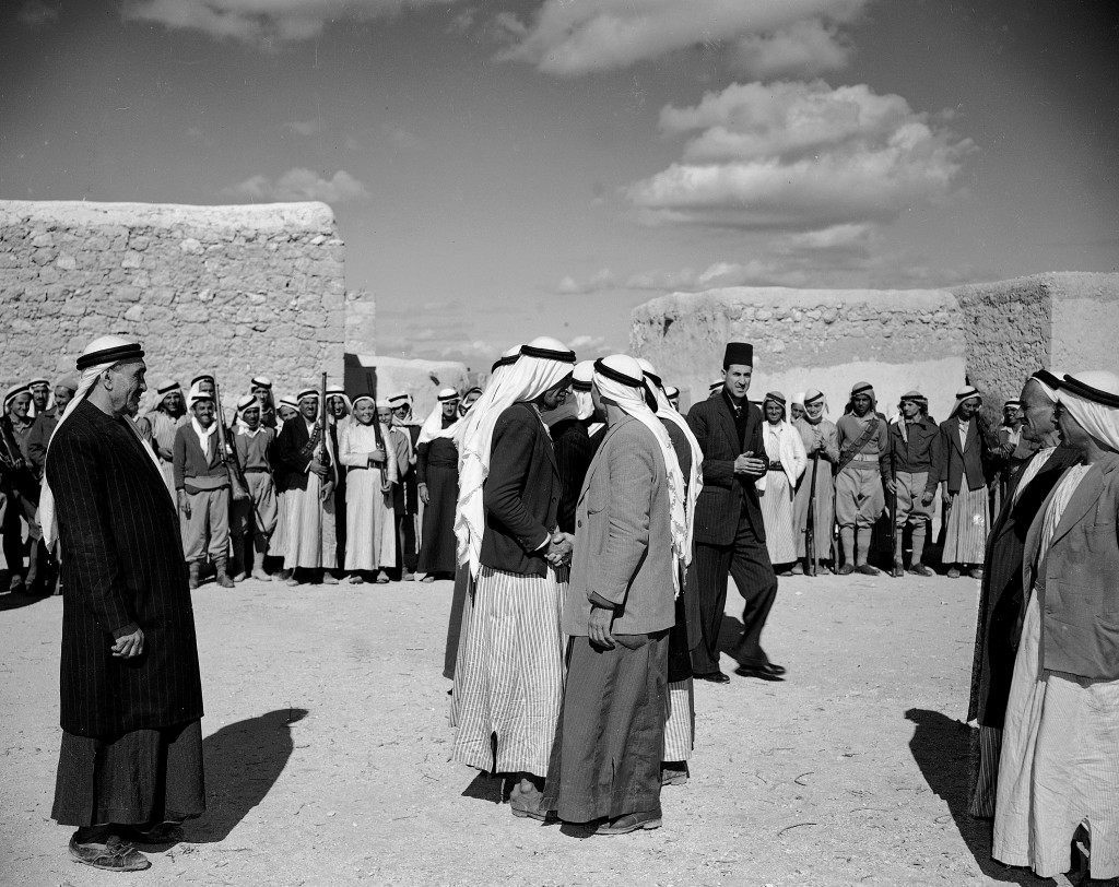 "Two feuding Arab families mark the end of the blood feud between them in Attil, Palestine, March 31, 1948, obeying the edict of regional Arab authorities that all feuds between Arabs must stop until ""the greater feud of Arab against Jew is ended."" (AP Photo) Ref #: PA.5737200 Date: 31/03/1948"
