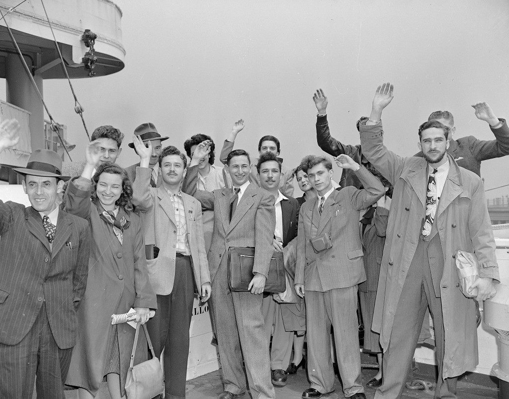 A group of Palestinian Jews aboard the American export liner Marine Carp wave goodbye prior to sailing from New York, May 4, 1948, for their native land to fight the Arabs. (AP Photo/Joe Caneva) Ref #: PA.5737223 Date: 04/05/1948