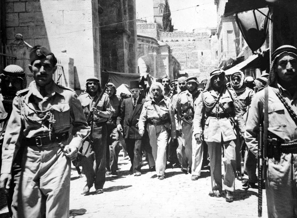King Abdullah of Transjordan, centre with beard, leaves the Church of the Holy Sepulchre, Jerusalem, May 27, 1948, escorted by members of the Arab Legion. The Jewish sector of the old city fell to arab forces on May 28. (AP Photo) Ref #: PA.5737226 Date: 27/05/1948