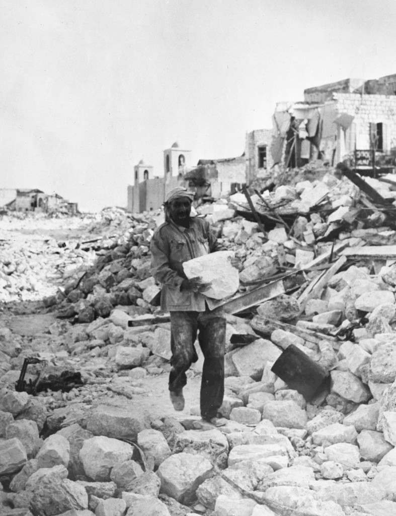 An arab workman is one of many who are assisting the Jewish authorities in Haifa, Israel, Nov. 8, 1948, in their great slum clearance scheme.(AP Photo/Staff/Pringle) Ref #: PA.5755039 Date: 08/11/1948