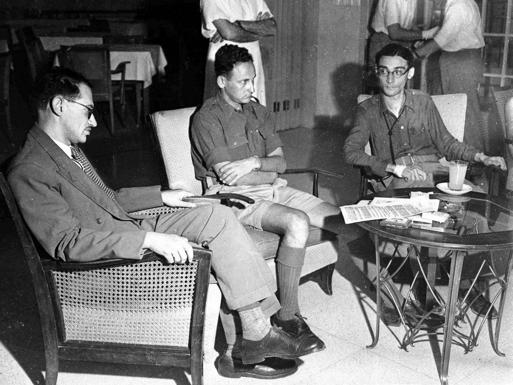 Leaders of the Jewish force, Irgun Zvei Leumi, announce to the press their acceptance of the demand by the Israeli provisional government for the immediate disbandment of Irgun, Jerusalem, Palestine, Sept. 21, 1948. Left to right; 'Karni', the spokesman of Irgun; 'Avinoam', the commander of the Irgun forces in Jerusalem; 'Leilerovits, liason officer. Following this acceptance soldiers of the Israeli army immediately commandeered arms at Irgun posts in the city. (AP Photo/Pringle) Ref #: PA.5755050 Date: 21/09/1948