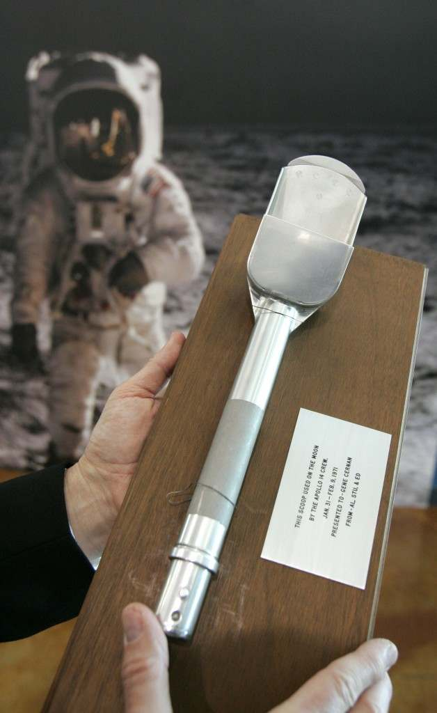 Shown in Dallas on Monday, March 24, 2008 is a scoop used by Alan Shepard and Edgar Mitchell to pick up moon dust on the Apollo 14 mission. It is one of the items included in the Heritage Auction Galleries, Air and Space Auction, Tuesday, at the Frontiers of Flight Museum in Dallas. (AP Photo/Donna McWilliam) Ref #: PA.5802540