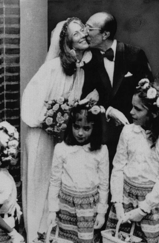 Houston heart surgeon Dr. Michael DeBakey, 67, plants a kiss on the cheek of his bride, actress Katrin Fehlhaber, 32, after their wedding on in this Saturday Aug. 9, 1975 file photo taken in Hamburg. In foreground are unidentified flower girls. DeBakey, the world-famous cardiovascular surgeon who pioneered such now-common procedures as bypass surgery and invented a host of devices to help heart patients, died Friday night July 11, 2008 at The Methodist Hospital in Houston, officials announced. He was 99. (AP Photo, FILE) Ref #: PA.6134023  Date: 09/08/1975