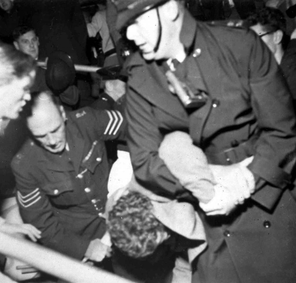 Beaulieu Jazz Festival Riot Police struggle with a youth in the grounds of Beaulieu Palace, Hampshire, July 30, 1960, after the Beaulieu Jazz Festival had turned into a riot. Youths and police fought in the grounds for several hours. (AP Photo) Ref #: PA.6138446