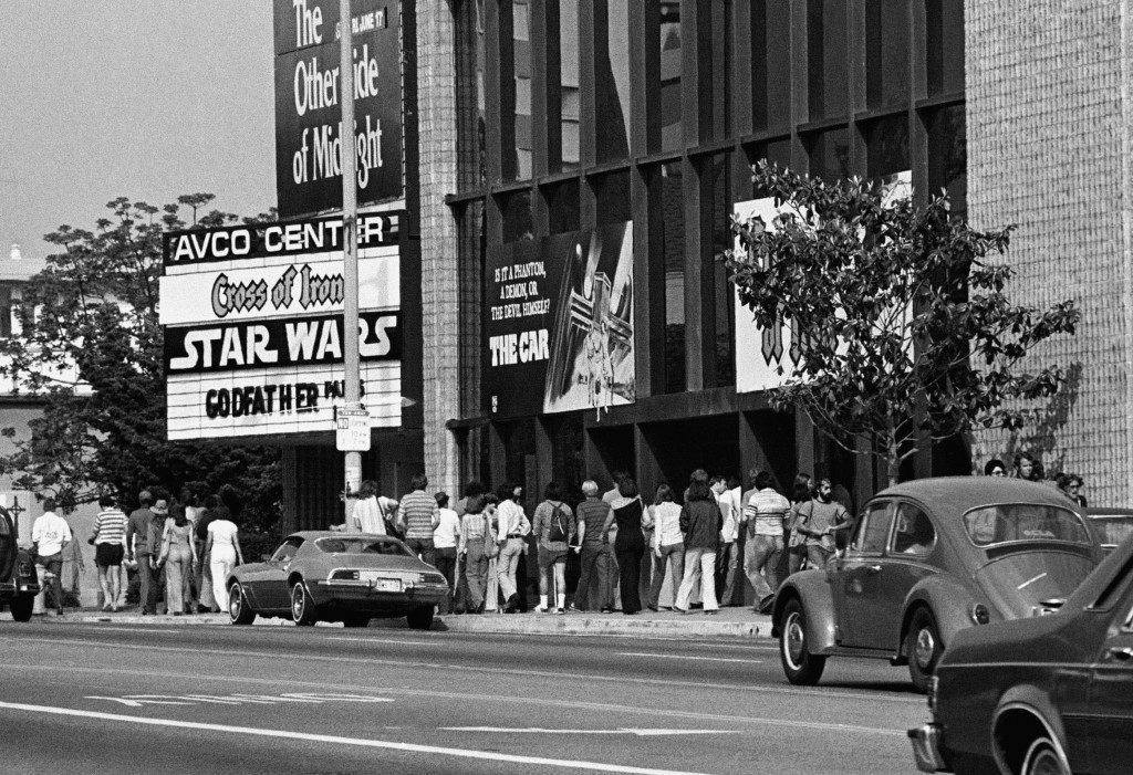 """Star Wars"" fan Danny Fitzgerald of Staten Island, in Darth Vader costume, poses in front of Loews Astor Plaza movie theater in Times Square in New York, May 25, 1983, where fans are lined up for the premiere of ""The Return of the Jedi,"" the third in a series of the ""Star Wars"" saga. (AP Photo/Dave Pickoff)"