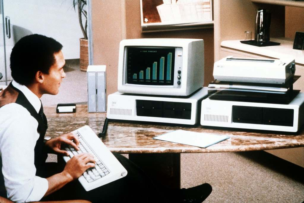 IBM Personal Computer - A man tries out the enhanced version of International Business Machines Corp's Personal Computer which was unveild in New York, March 8, 1983. IBM also introduced several other related products including devices that boost the memory of its existing machine, a color display terminal and new software, or programs, to run both the personal computer and the new model. (AP-Photo)
