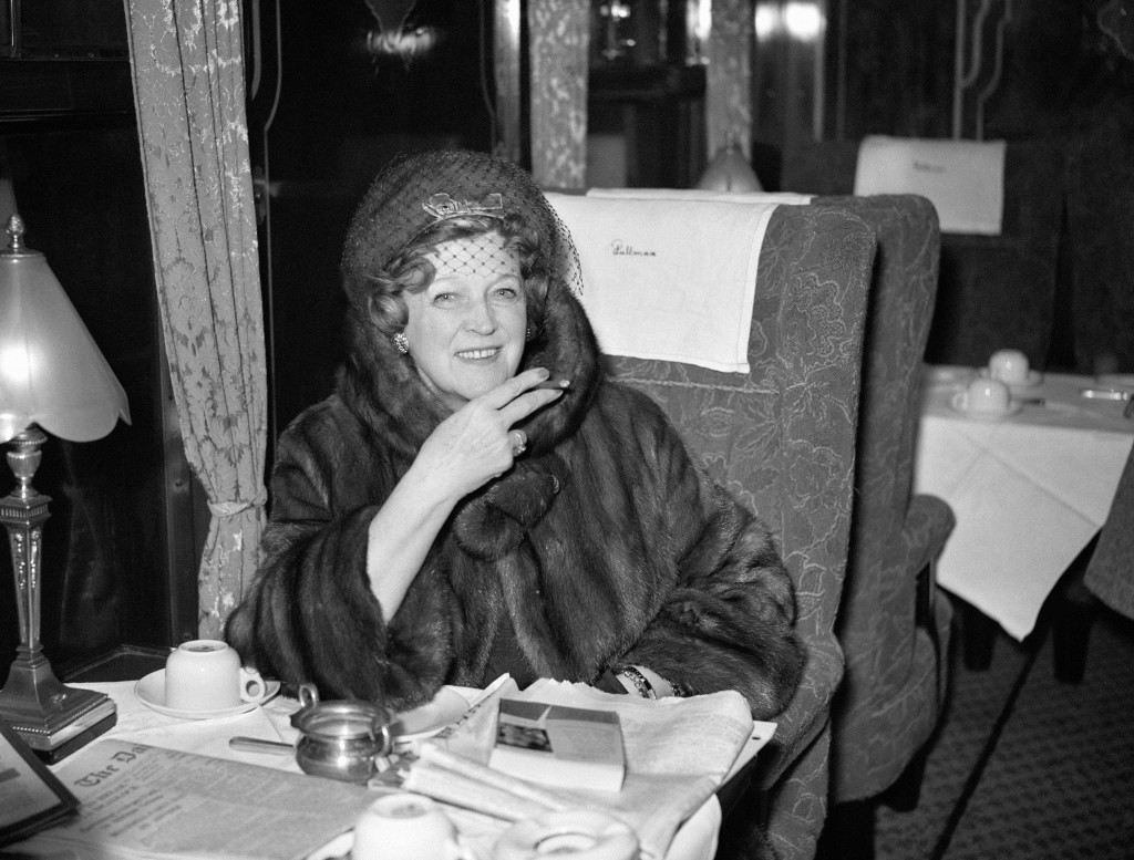 Countess Beauchamp smoking a cheroot aboard the 'United States' boat train at Waterloo. Ref #: PA.6819597  Date: 20/01/1960