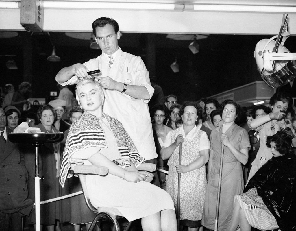 Gunther Roeffen of West germany at work on a rinse at the hairdressing exhibition at the New Agricultural hall in central London. Ref #: PA.6927717 Date: 25/05/1959
