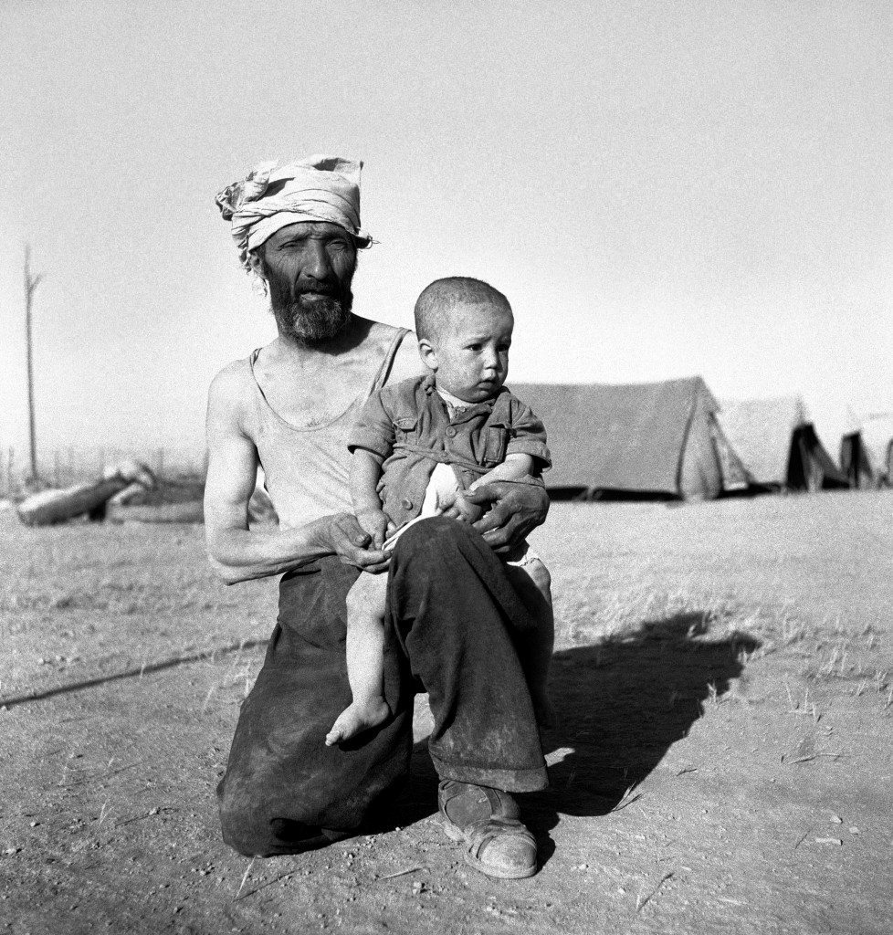 Israel Koperlov, 1 years of age, on the knee of his father, Chaim Koperlov awaiting sunset check by Legion guards on June 4, 1948 in Trans Jordan. (AP Photo/Daniel De Luce ) Ref #: PA.7091313 Date: 04/06/1948