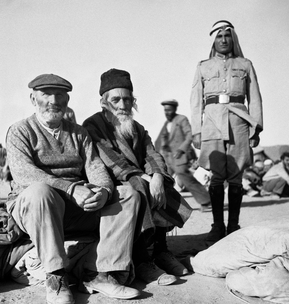 Legion guards with two orthodox Jews who preferred imprisonment in Trans-Jordan to going into Jewish-held area of Jerusalem, which is also still a battle zone on June 4, 1948 in Trans-Jordan. (AP Photo/Daniel De Luce ) Ref #: PA.7091318 Date: 04/06/1948