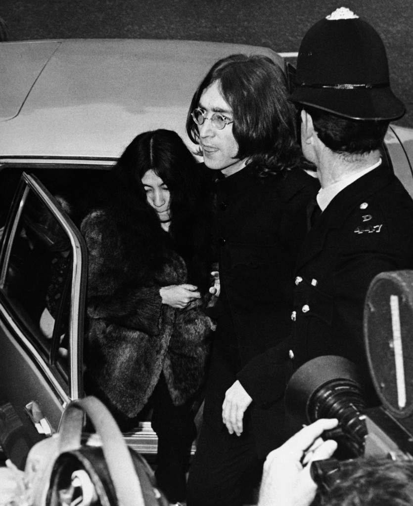 John Lennon, one of the Beatles, and his Japanese girl friend, Yoko Ono, leave car to enter Marylebone court in London on Oct. 19, 1968. They appeared on charges of possessing cannabis, the British name for hashish. The trial was set for late November after the police asked for time to have the seized drugs analyzed. (AP Photo) Ref #: PA.7212022  Date: 19/10/1968