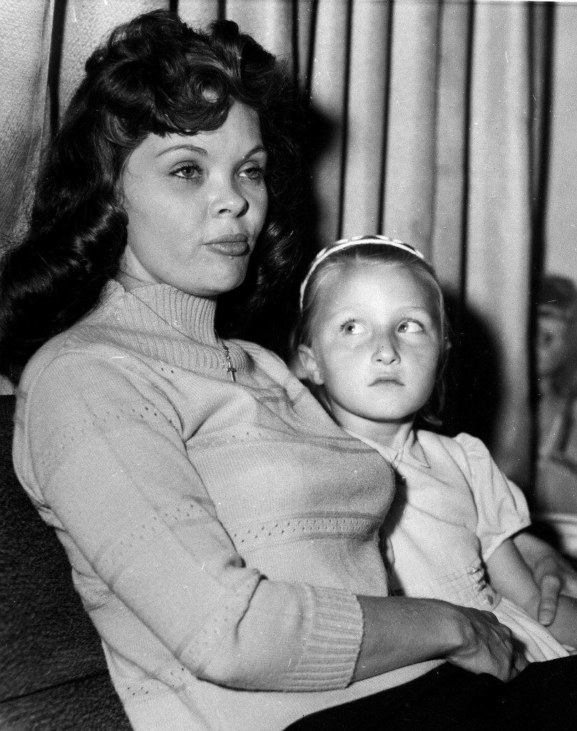 Burlesque dancer Candy Barr, left, gets an affectionate look from her daughter, Troylene, after she arrived at her parents home, April 2, 1963, Edna, Texas. Candy Barr, an ex-stripper, walked out of Goree Prison after being paroled. She served three years and four months of a 15-year sentence for possession of Marijuana. Candy Barr, whose legal name when she was convicted was Mrs. Juanita Phillips. Before she entered prison she married her third husband, Jack Sakhian of Hollywood, Calif., and she said she would like to live with him now that she is out of prison. The 5-foot, 3-inch blonde former entertainer said all she wanted to do was enjoy her family. (AP Photo) Ref #: PA.7214011